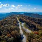 Blue Ridge Parkway splits a mountainous ridge surrounded by trees