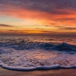 Cape Henlopen State Park ocean beach at sunset